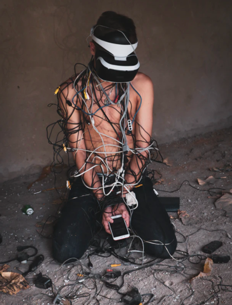 Person in a mess of cables